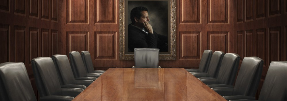 Wood-conf-table-and-walls-w-picture-and-w-black-leather-chairs-iStock_000003796784Large-e1410231384845