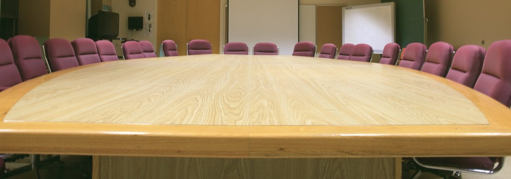 large-wood-conf-table-w-pink-chairs-iStock_000021478200Medium-e1410232427802